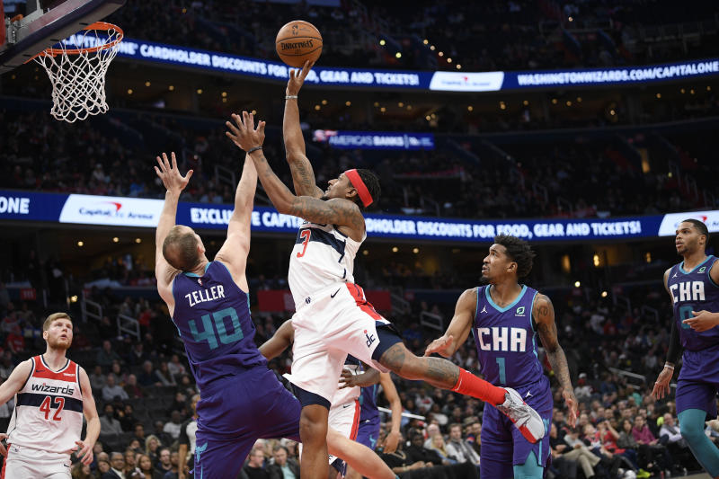 Washington Wizards guard Bradley Beal (3) goes to the basket as Charlotte Hornets forward Cody Zeller (40) and guard Malik Monk (1) defend during the second half of an NBA basketball game, Friday, Nov. 22, 2019, in Washington. Also seen is Wizards forward Davis Bertans (42). The Wizards won 125-118. (AP Photo/Nick Wass)