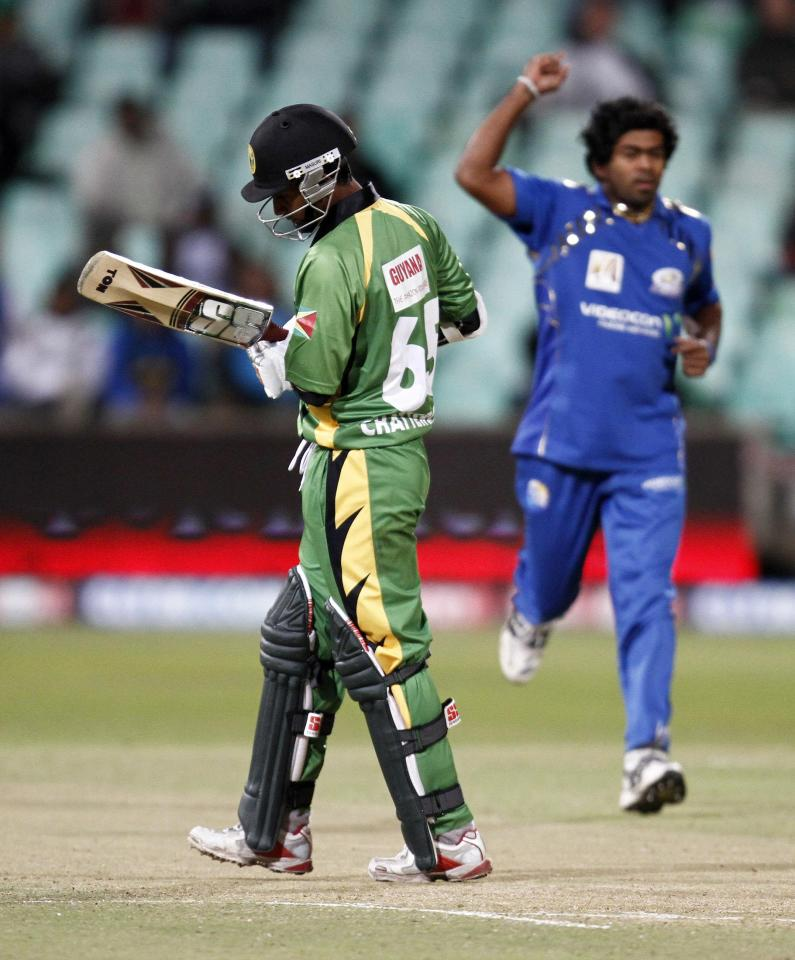 DURBAN, SOUTH AFRICA - SEPTEMBER 16:  Sewnarine Chattergoon walks off after losing his wicket to Lasith Malinga  during the Airtel Champions League Twenty20 match between Mumbai Indians and Guyana at Sahara Kingsmead Stadium on September 16, 2010 in Durban, South Africa.  (Photo by Anesh Debiky/Gallo Images/Getty Images)