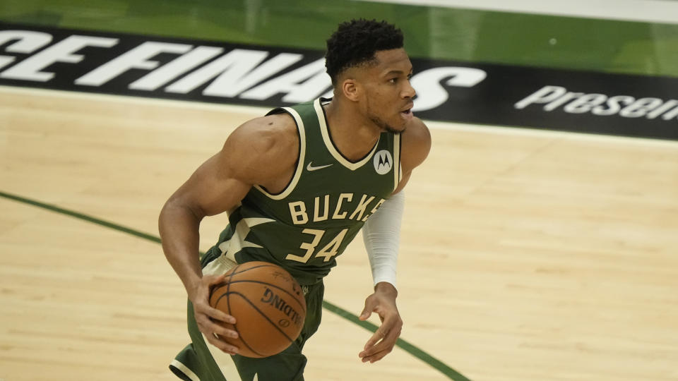 Milwaukee Bucks' Giannis Antetokounmpo dribbles during the first half of Game 1 of the NBA Eastern Conference basketball finals game against the Atlanta Hawks Wednesday, June 23, 2021, in Milwaukee. (AP Photo/Morry Gash)