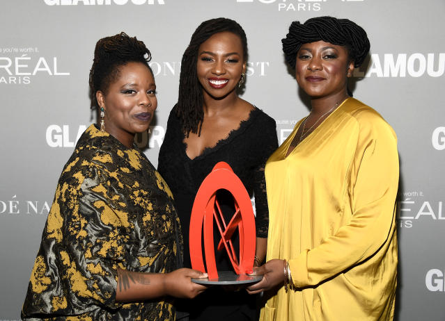 Honorees Patrisse Khan-Cullors, Opal Tometi, and Alicia Garza pose with an award during Glamour Women of the Year 2016 at NeueHouse Hollywood in 2016. (Photo: Frazer Harrison/Getty Images for Glamour)
