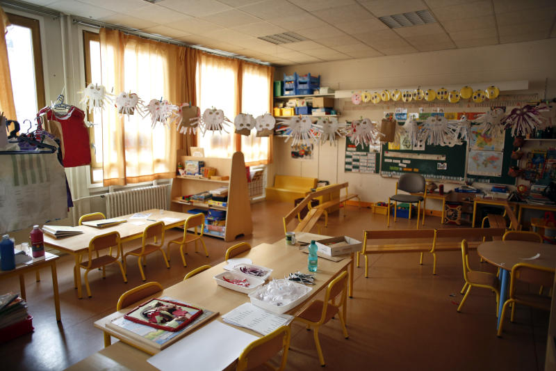 An empty classroom is seen at a closed school in Paris, Monday, March 16, 2020. France plans to close all creches, schools and universities from Monday until further notice to limit the spread of the novel coronavirus, President Emmanuel Macron says. For most people, the new coronavirus causes only mild or moderate symptoms. For some it can cause more severe illness, especially in older adults and people with existing health problems. (AP Photo/Thibault Camus)