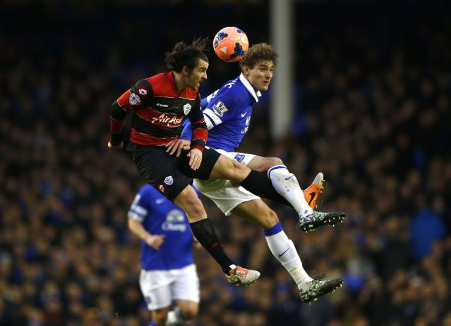 Everton's Nikica Jelavic (R) challenges Queens Park Rangers Joey Barton during their English FA Cup soccer match at Goodison Park in Liverpool, northern England January 4, 2014. REUTERS/Darren Staples (BRITAIN - Tags: SPORT SOCCER)