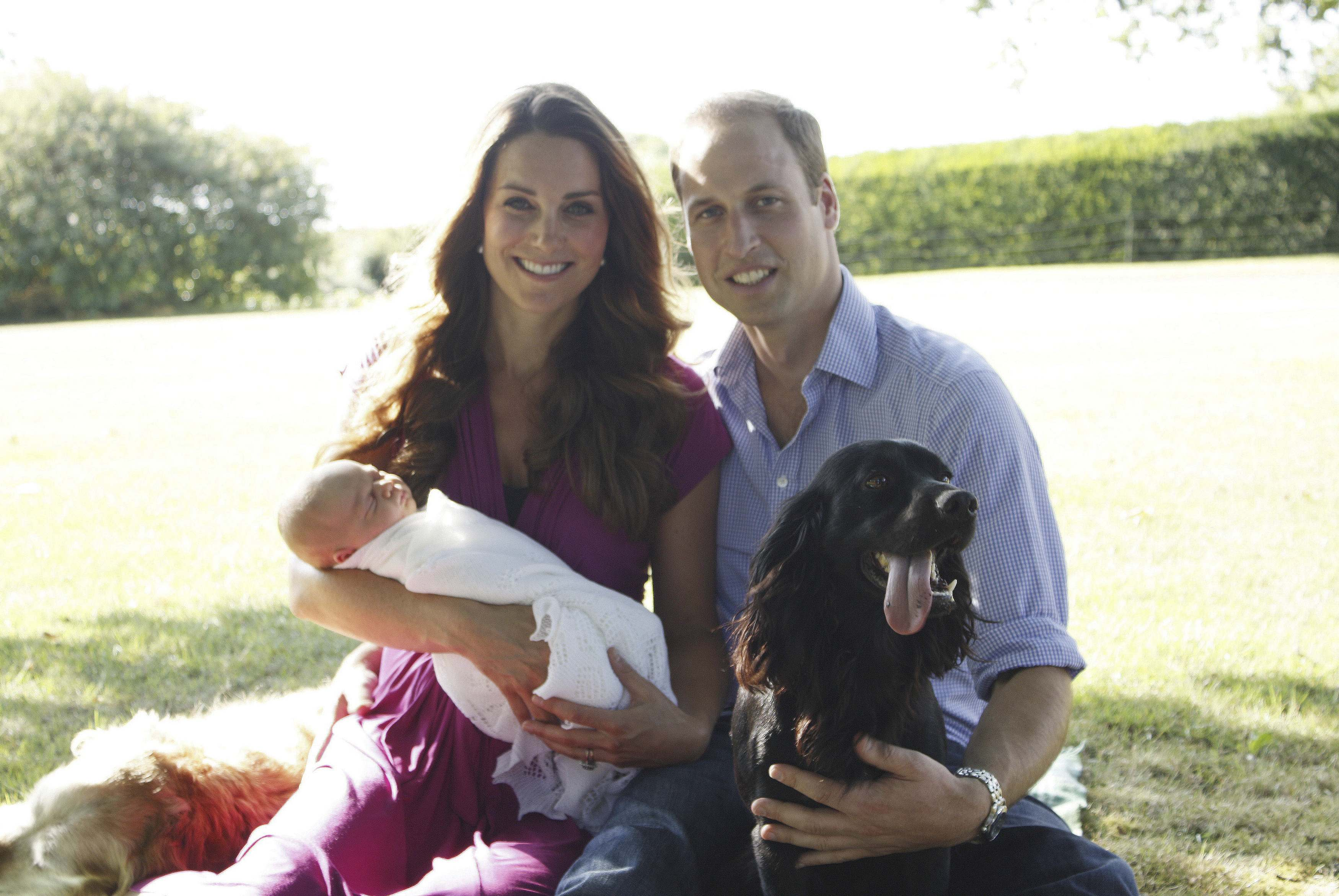 Britain's Prince William and his wife Catherine, Duchess of Cambridge, pose in the garden of the Middleton family home in Bucklebury, southern England, with their son Prince George, cocker spaniel Lupo (R) and Middleton family pet Tilly, in this undated photograph released in London August 19, 2013. REUTERS/Michael Middleton/The Duke and Duchess of Cambridge/Handout via Reuters (BRITAIN - Tags: ROYALS ENTERTAINMENT SOCIETY ANIMALS) NO COMMERCIAL OR BOOK SALES. FOR EDITORIAL USE ONLY. NOT FOR SALE FOR MARKETING OR ADVERTISING CAMPAIGNS. THIS IMAGE HAS BEEN SUPPLIED BY A THIRD PARTY. IT IS DISTRIBUTED, EXACTLY AS RECEIVED BY REUTERS, AS A SERVICE TO CLIENTS. NO THIRD PARTY SALES. NOT FOR USE BY REUTERS THIRD PARTY DISTRIBUTORS