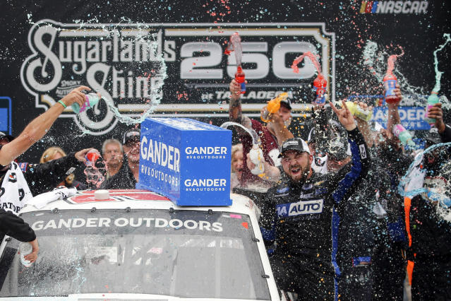 Camping World Truck Series driver Spencer Boyd (20) celebrates in Victory Lane after being declared the winner as driver Johnny Sauter (13) was disqualified during the Sugarlands Shine 250 at Talladega Superspeedway, Saturday, Oct 12, 2019, in Talladega, Ala. (AP Photo/Butch Dill)