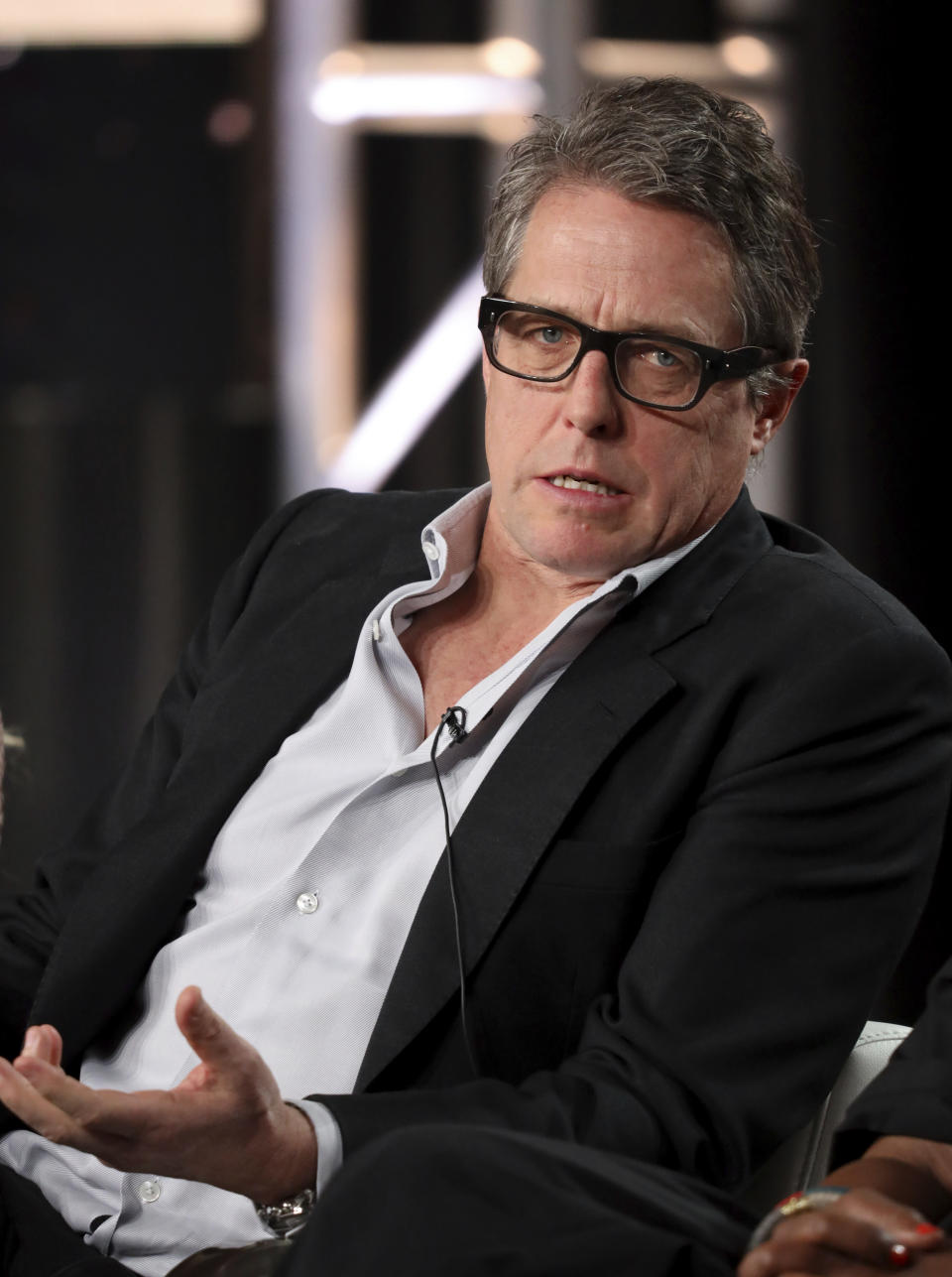 """Hugh Grant speaks at the """"The Undoing"""" panel during the HBO TCA 2020 Winter Press Tour at the Langham Huntington on Wednesday, Jan. 15, 2020, in Pasadena, Calif. (Photo by Willy Sanjuan/Invision/AP)"""