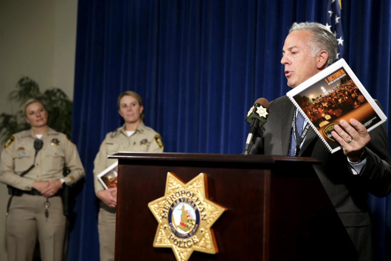Clark County Sheriff Joe Lombardo announces the release of the Oct. 1, 2017, shooting After-Action Review with report authors Detective Stephanie Ward, left, and Capt. Kelly McMahill during a news conference at Metropolitan Police Department headquarters Las Vegas Wednesday, July 10, 2019. The report details what the department learned from the deadliest mass shooting in modern U.S. history.  (K.M. Cannon/Las Vegas Review-Journal via AP)