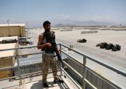 An Afghan soldier stands guard on a security tower in Bagram U.S. air base, after American troops vacated it, in Parwan province