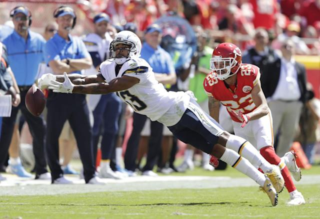 <p>Wide receiver Keenan Allen #13 of the San Diego Chargers stretches for the ball as defensive back Phillip Gaines #23 of the Kansas City Chiefs defends during the game at Arrowhead Stadium on September 11, 2016 in Kansas City, Missouri. (Photo by Jamie Squire/Getty Images) </p>