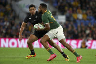 South Africa's Lukhanyo Am, right, runs past New Zealand's Anton Lienert-Brown during their Rugby Championship test match on the Gold Coast, Australia, Saturday, Oct. 2, 2021. (AP Photo/Tertius Pickard)