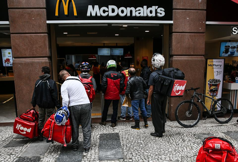 SAO PAULO, BRAZIL - MARCH 08: Food delivery couriers wait in line at a McDonald's restaurant in downtown during the first business day after the state of Sao Paulo declared the most restrictive