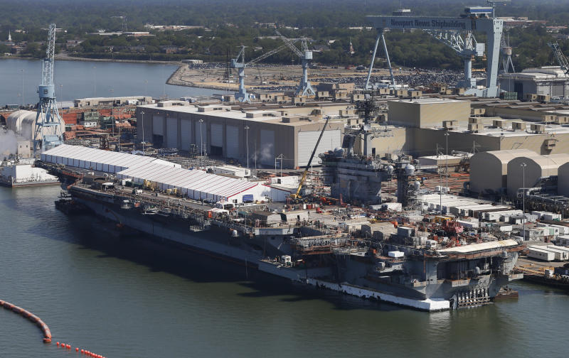 "FILE - This April 27, 2016, file photo, shows the nuclear powered aircraft carrier USS Abraham Lincoln at Newport News Shipbuilding in Newport News, Va. The U.S. is dispatching the USS Abraham Lincoln and other military resources to the Middle East following ""clear indications"" that Iran and its proxy forces were preparing to possibly attack U.S. forces in the region, according to a defense official on May 5, 2019. (AP Photo/Steve Helber, File)"
