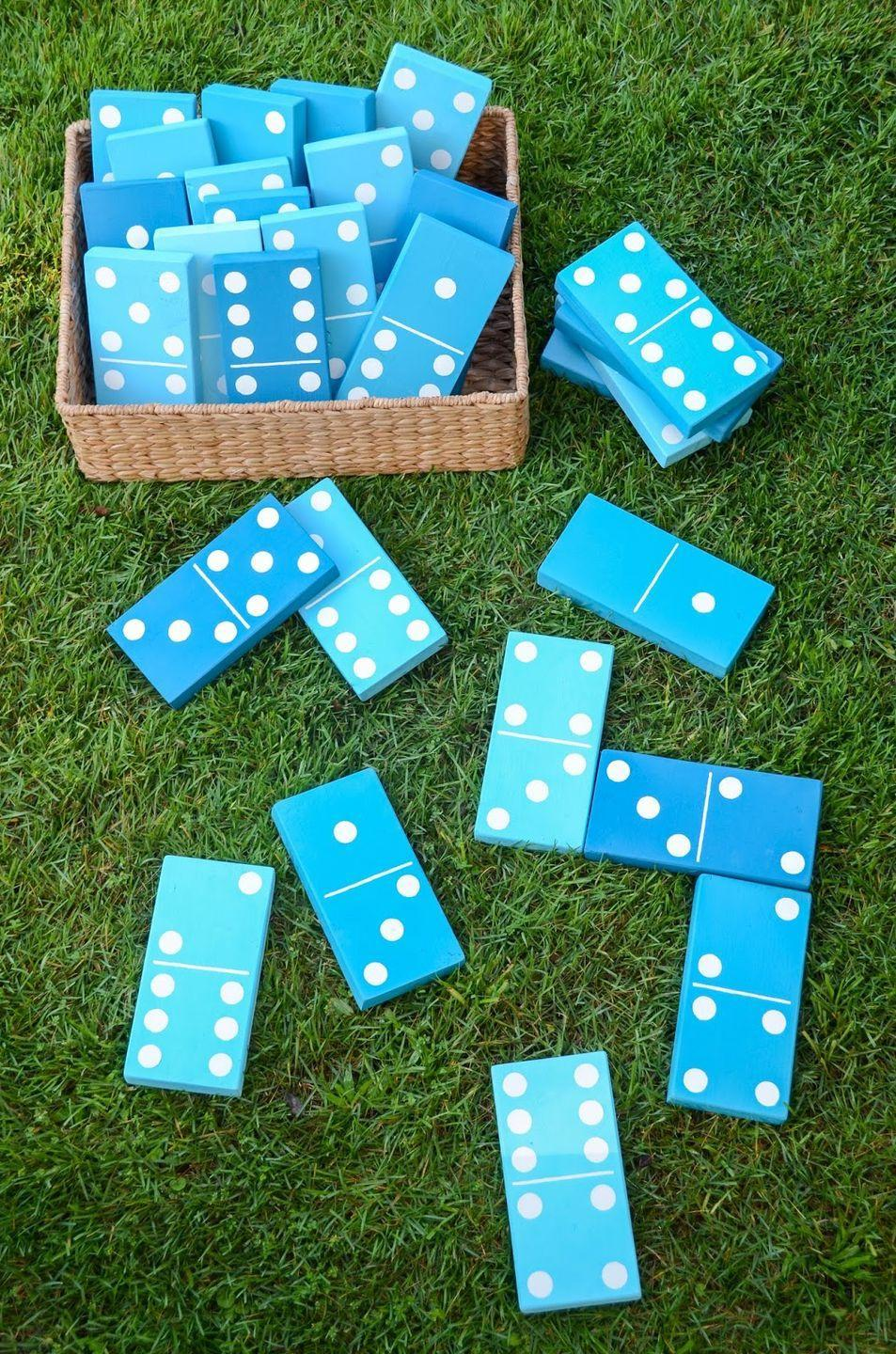 """<p>Once complete, these giant lawn dominoes are sure to be a family favorite for outdoor game nights and barbecues. Opt for a simple palette in bright hues like the turquoise one shown. </p><p><strong>Get the tutorial at <a href=""""https://www.ironandtwine.com/blog/2014/06/diy-lawn-dominoes.html"""" rel=""""nofollow noopener"""" target=""""_blank"""" data-ylk=""""slk:iron & twine"""" class=""""link rapid-noclick-resp"""">iron & twine</a>. </strong></p><p><a class=""""link rapid-noclick-resp"""" href=""""https://www.amazon.com/3M-9005NA-Aluminum-Sandpaper-Assorted/dp/B00004Z48U/?tag=syn-yahoo-20&ascsubtag=%5Bartid%7C2164.g.36687460%5Bsrc%7Cyahoo-us"""" rel=""""nofollow noopener"""" target=""""_blank"""" data-ylk=""""slk:SHOP SANDPAPER"""">SHOP SANDPAPER</a></p>"""