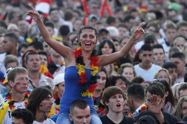 "Supporters of the German national football team cheer up their team during the public screening of Germany's opening match against Portugal in the Euro 2012 football championships at the ""Fanmeile"" (Fan Mile) in Berlin on June 9, 2012. AFP PHOTO / MICHELE TANTUSSIMICHELE TANTUSSI/AFP/GettyImages"