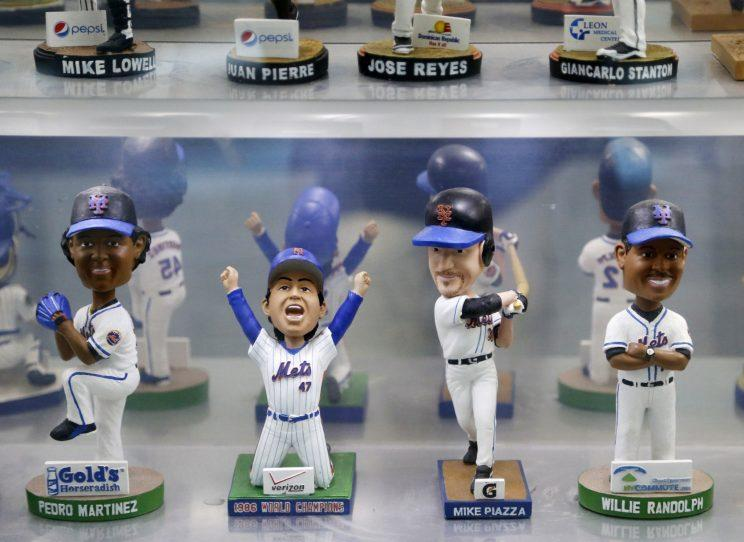 Some of the bobbleheads at the Bobblehead Museum in Marlins Park stadium are shown on display before a baseball game between the Miami Marlins and the Pittsburgh Pirates, Thursday, June 2, 2016, in Miami. (AP Photo/Wilfredo Lee)