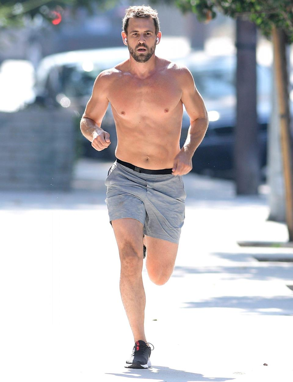 <p>Nick Viall works up a sweat while out for a shirtless run in L.A. on Tuesday. </p>