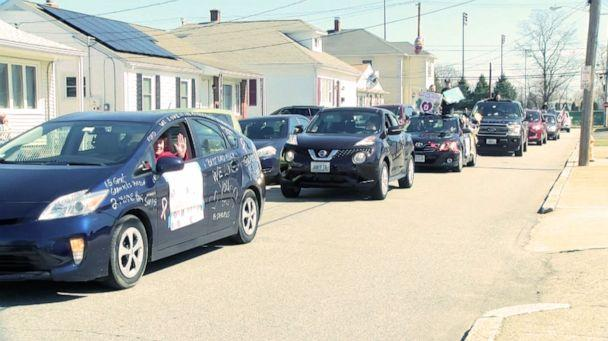PHOTO: Alfred Vecoli of Pawtucket, R.I., is treated to a parade of cars filled with family members in honor of his 92nd birthday, March 22, 2020. (WLNE)