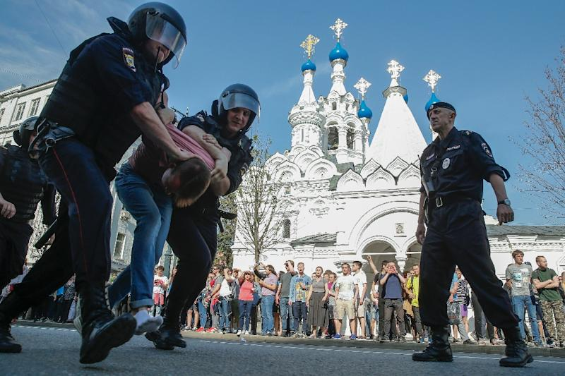 Russian police officers detaining a protester during an unauthorized anti-Putin rally called by opposition leader Alexei Navalny in May in Moscow (AFP Photo/Maxim ZMEYEV)