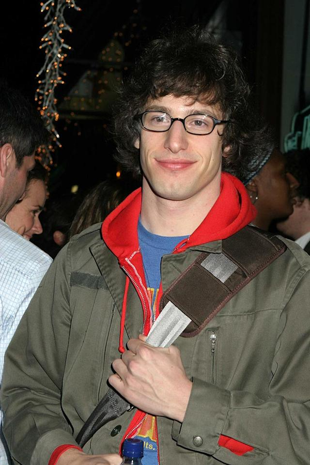 "Funnyman Andy Samberg sports his trademark grin, glasses, and curly mane at a ""Saturday Night Live"" afterparty at New York's Metropolitan Cafe. Roger Wong/<a href=""http://www.infdaily.com"" target=""new"">INFDaily.com</a> - March 12, 2006"