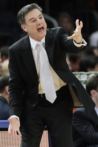Louisville head coach Rick Pitino calls out to his team in the first half of a second-round NCAA college basketball game against Seton Hall at the Big East tournament in New York, Wednesday, March 7, 2012. (AP Photo/Frank Franklin II)
