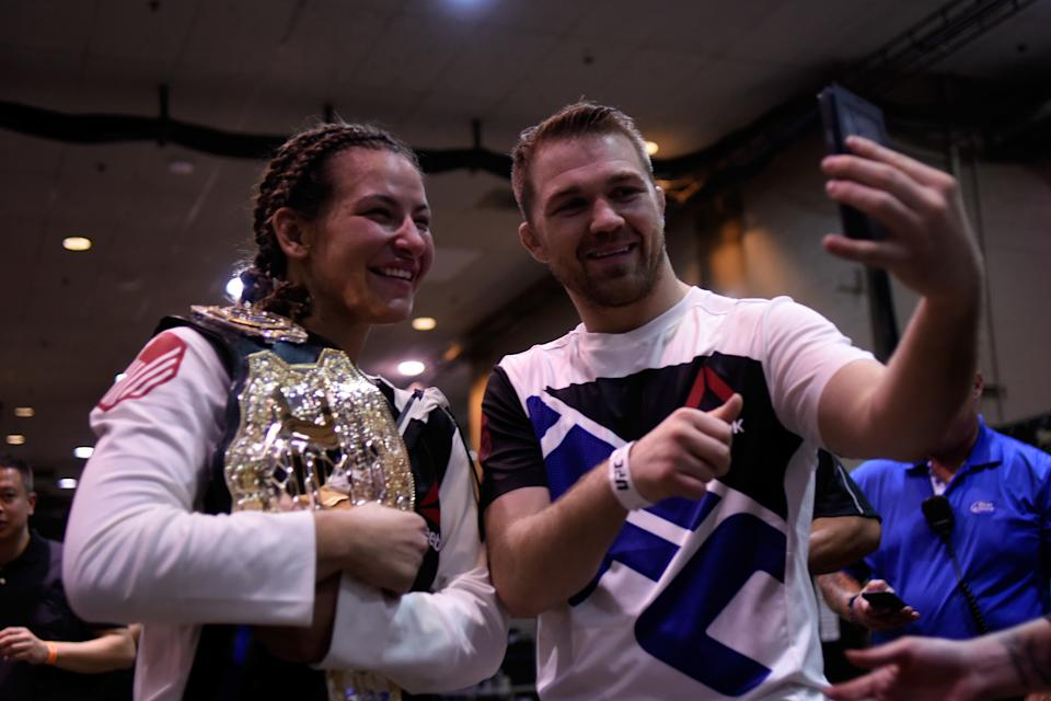 Miesha Tate celebrates with boyfriend Bryan Caraway backstage during the UFC 196 event inside MGM Grand Garden Arena on March 5, 2016 in Las Vegas, Nevada.  (Photo by Todd Lussier/Zuffa LLC/Zuffa LLC via Getty Images)