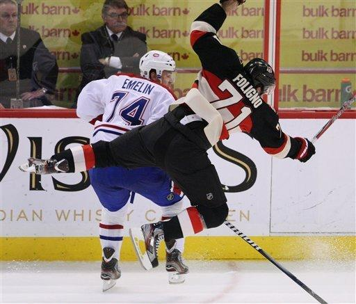 Montreal Canadiens Alexei Emelin (74)checks Ottawa Senators Nick Foligno(71) during second period NHL hockey action in Ottawa Tuesday Dec. 27, 2011. (AP Photo/The Canadian Press, Fred Chartrand)