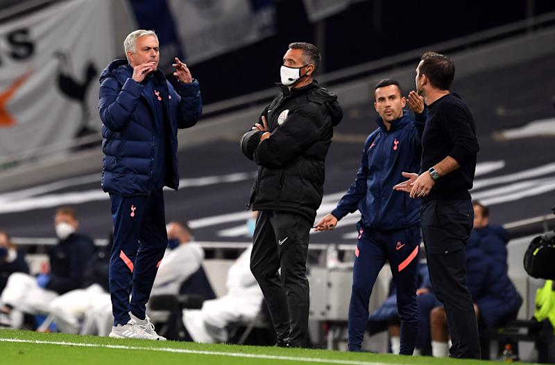 Tottenham manager Jose Mourinho (left) and his Chelsea counterpart Frank Lampard (right) got into an animated discussion during Tuesday's EFL Cup match between the teams. (Neil Hall/Getty Images)