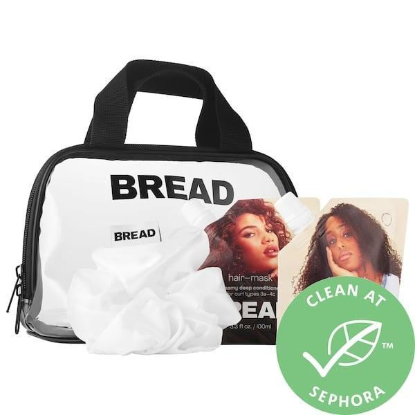 """<p>Not only does it come with a little travel pouch and a silky scrunchie, but this <span>Bread Beauty Supply Snac Pac Travel Size Wash-Day Essentials For Curly and Textured Hair</span> ($24) also has a hair mask that one editor is already <a href=""""https://www.popsugar.com/beauty/bread-beauty-supply-hair-mask-hair-oil-hair-wash-review-47671453"""" class=""""link rapid-noclick-resp"""" rel=""""nofollow noopener"""" target=""""_blank"""" data-ylk=""""slk:&quot;most thankful for in 2020.&quot;"""">""""most thankful for in 2020.""""</a></p>"""