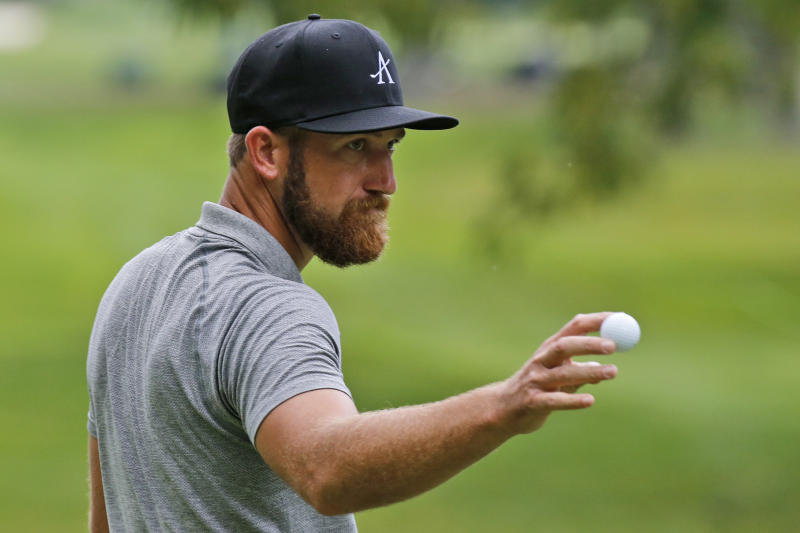 Kevin Chappell tips his ball to the crowd on the ninth hole during the second round of A Military Tribute at The Greenbrier golf tournament in White Sulphur Springs, W.Va., Friday, Sept. 13, 2019. (AP Photo/Steve Helber)