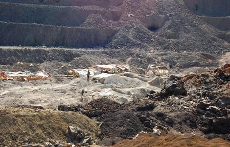 FILE PHOTO: Artisanal miners work at the Tilwezembe, a former industrial copper-cobalt mine, outside of Kolwezi, the capital city of Lualaba Province in the south of the Democratic Republic of the Congo