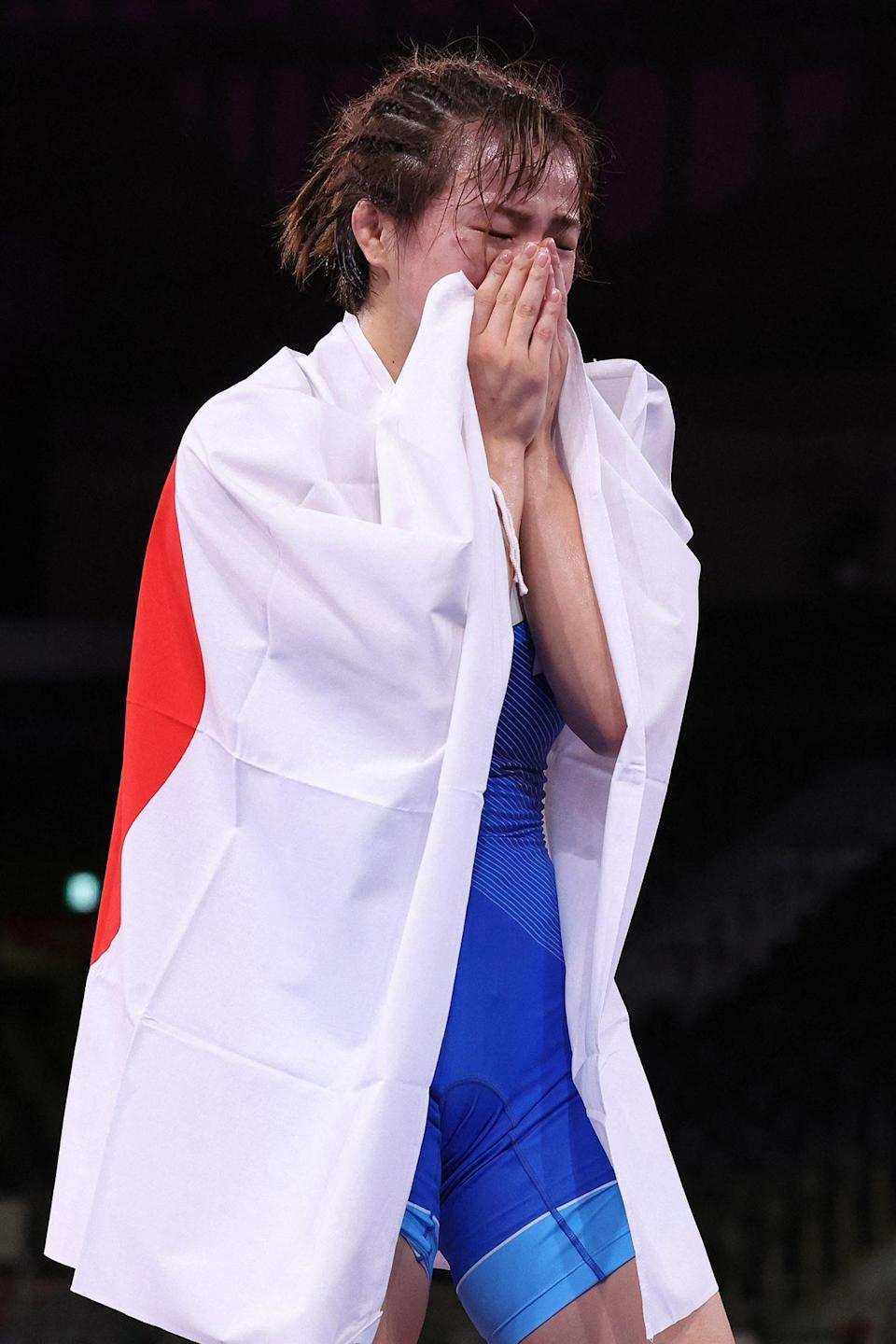 <p>Japan's Yukako Kawai gets emotional after winning her gold medal in the women's freestyle 62kg wrestling competition at the Makuhari Messe on August 4.</p>