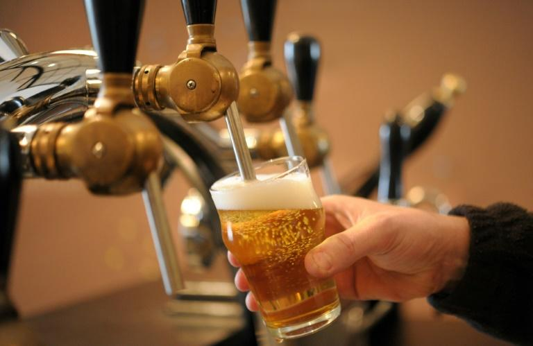 Regularly drinking more than 100 grammes (3.5 ounces) of alcohol per week -- about five or six medium glasses of wine or pints of beer -- was linked to a shorter life expectancy for men and women, according to research published in The Lancet