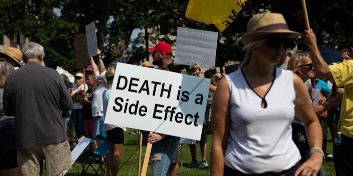 Demonstrators gather with signs and flags to protest against mandated vaccines outside of the Michigan State Capitol on August 6, 2021 in Lansing, Michigan. There were 44 counties in Michigan at high or substantial levels of community coronavirus transmission, according to the U.S. Centers for Disease Control and Preventions case and test positivity criteria as of August 5, 2021.