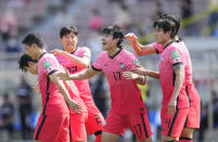 South Korea's Song Min-kyu, center, celebrates after scoring his side's first goal against Lebanon during their Asian zone Group H qualifying soccer match for the FIFA World Cup Qatar 2022 at Goyang stadium in Goyang, South Korea, Sunday, June 13, 2021. (AP Photo/Lee Jin-man)