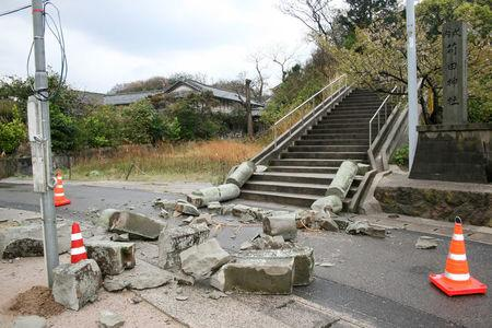 A stone torii gate damaged by an earthquake is seen at Karita Shrine in Ohda, Shimane Prefecture, Japan in this photo taken by Kyodo April 9, 2018.  Mandatory credit Kyodo/via REUTERS
