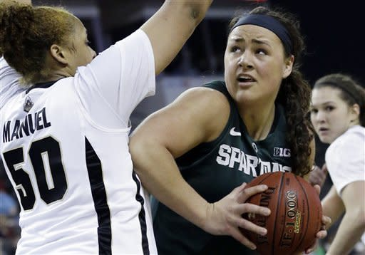 Michigan State center Jasmine Hines, right, looks to the basket as Purdue forward Taylor Manuel guards during the first half of an NCAA college basketball game in the Big Ten Conference tournament in Hoffman Estates, Ill., on Sunday, March 10, 2013. (AP Photo/Nam Y. Huh)