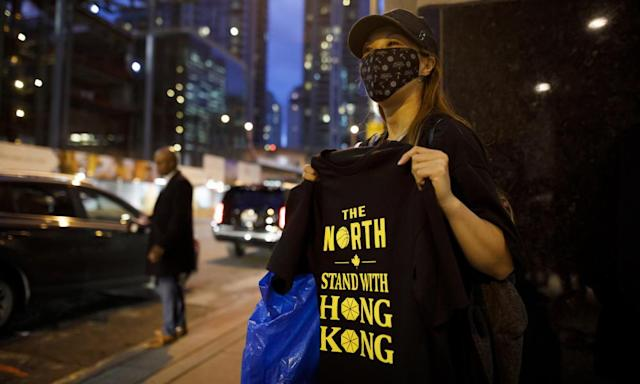 """<span class=""""element-image__caption"""">Pro-Hong Kong activists hand out t-shirts outside of the Toronto Raptors game on Tuesday.</span> <span class=""""element-image__credit"""">Photograph: Cole Burston/Getty Images</span>"""