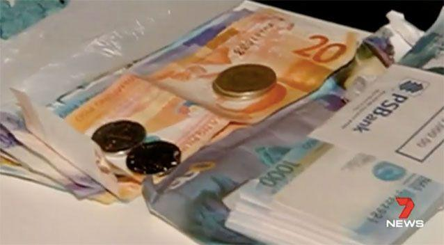 The money confiscated in the investigation. Source: 7News