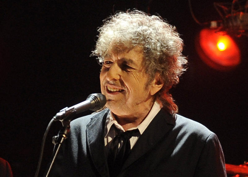 """FILE - In this Jan. 12, 2012 file photo, Bob Dylan performs in Los Angeles. The electric guitar that Bob Dylan plugged in at the Newport Folk Festival in 1965 may be the most historic instrument in rock music, and it has sat mostly unnoticed in a New Jersey attic for most of the 47 years since. Dylan left it behind in an airplane and it was taken home by the pilot. The late pilot's daughter recently took it to PBS' """"History Detectives,"""" who authenticated the potentially fortune-making find in an episode that will air starting next Tuesday, July 17. (AP Photo/Chris Pizzello, File)"""