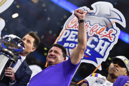 LSU head coach Ed Orgeron celebrates after the team's Peach Bowl NCAA semifinal college football playoff game against Oklahoma, Saturday, Dec. 28, 2019, in Atlanta. LSU won 63-28. (AP Photo/John Amis)