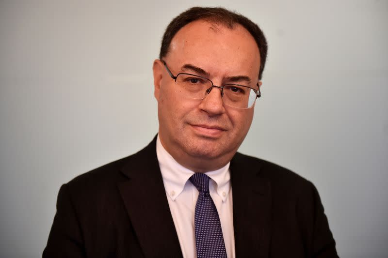 FILE PHOTO: Andrew Bailey, CEO of the Financial Conduct Authority, poses for a photo as he arrives at the Reuters offices for an interview in London