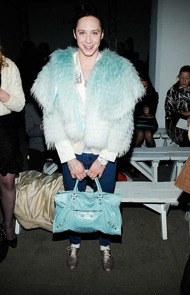 "A few days later, the wannabe fashionista attended Isaac Mizrahi's show at Exit Art in this outrageous outfit. What's the worst part of Johnny's ensemble ... his futuristic fur coat, his skinny denim floods, his sparkly saddle shoes, or his aqua purse? We can't decide! Joe Kohen/<a href=""http://www.wireimage.com"" target=""new"">WireImage.com</a> - February 17, 2011"