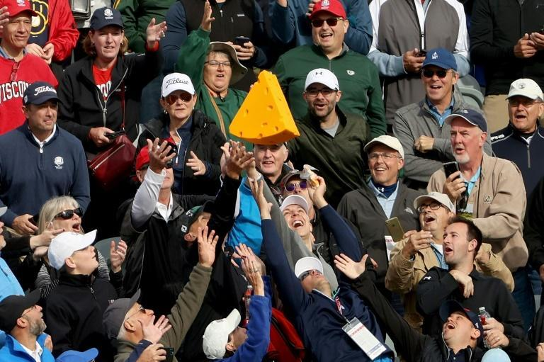 Making friends: Ryder Cup fans try to catch a cheesehead hat tossed by one of Europe's players during a practice round at Whistling Straits (AFP/Patrick Smith)
