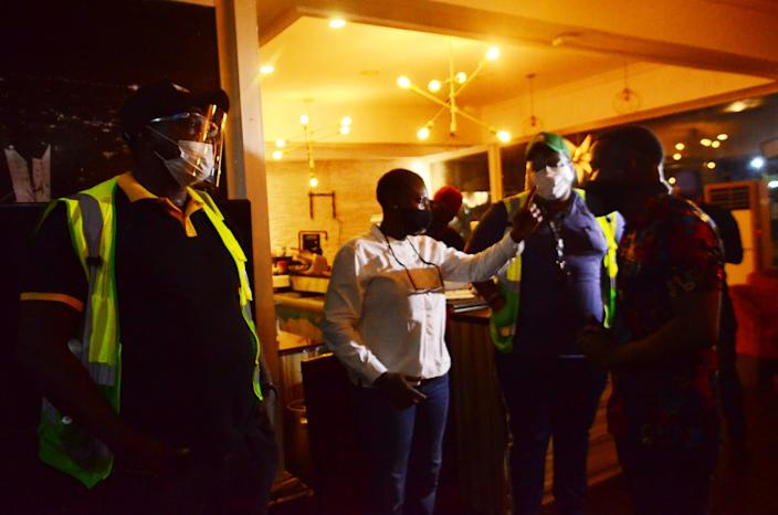 """Officials of Lagos State Environmental Protection Agency discussing with the manager of a restaurant while inspecting hospitality business violators on July 19, 2020. <p class=""""copyright"""">Olukayode Jaiyeola/NurPhoto via Getty Images</p>"""