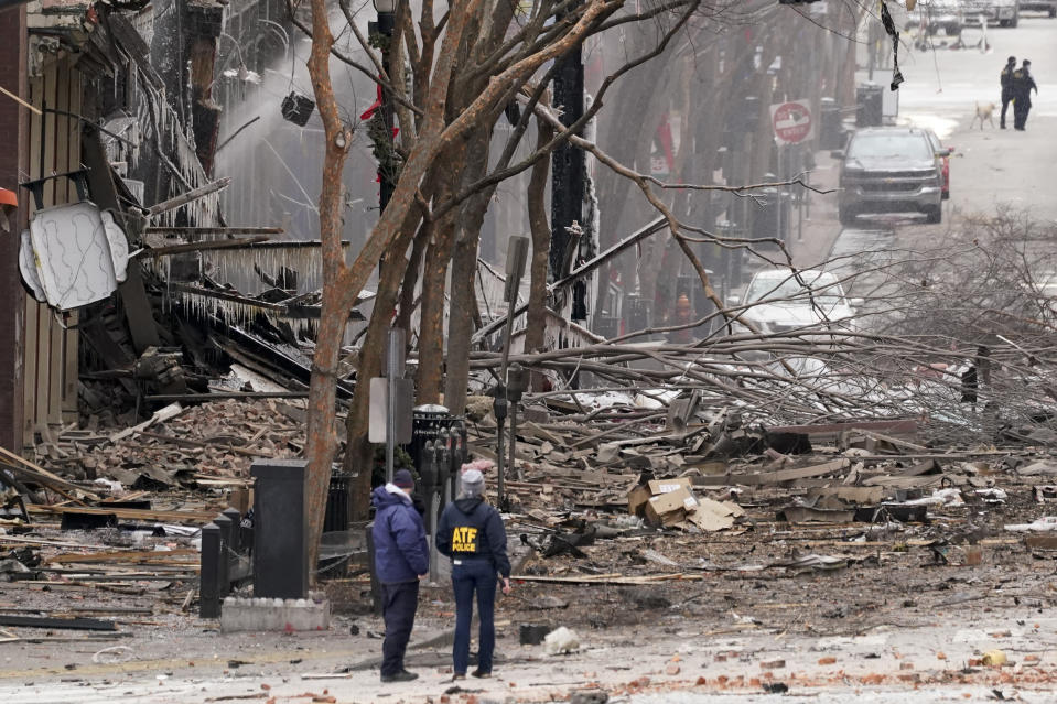 Emergency personnel work near the scene of an explosion in downtown Nashville, Tenn., Friday, Dec. 25, 2020. Buildings shook in the immediate area and beyond after a loud boom was heard early Christmas morning.(AP Photo/Mark Humphrey)
