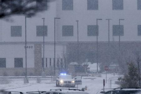 A police vehicle is seen left with the doors open at a Planned Parenthood center at 3480 Centennial Boulevard after reports of an active shooter in Colorado Springs, Colorado November 27, 2015. REUTERS/Isaiah J. Downing