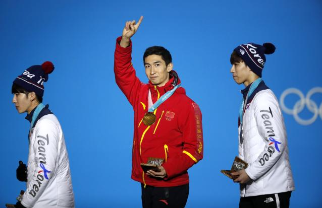 Medals Ceremony - Short Track Speed Skating Events - Pyeongchang 2018 Winter Olympics - Men's 500m - Medals Plaza - Pyeongchang, South Korea - February 23, 2018 - Gold medalist Wu Dajing of China, silver medalist Hwang Dae-heon of South Korea and bronze medalist Lim Hyo-jun of South Korea. REUTERS/Kim Hong-Ji