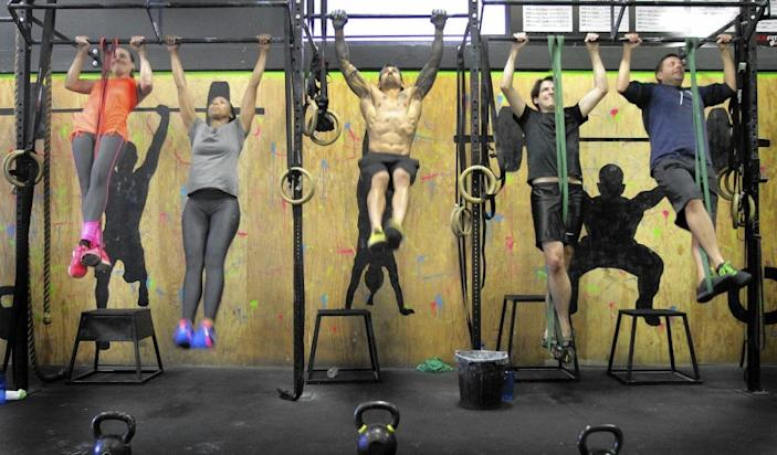 Devotees hang out together in a class at Cave CrossFit.