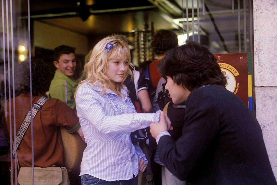 <p>Lizzie styled her ruffled button-down blouse with matching bedazzled hair clips, of course.</p>