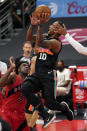 San Antonio Spurs forward DeMar DeRozan (10) shoots over Toronto Raptors forward OG Anunoby (3) during the first half of an NBA basketball game Wednesday, April 14, 2021, in Tampa, Fla. (AP Photo/Chris O'Meara)