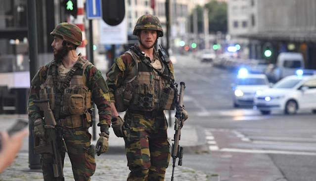 <p>Belgian Army soldiers patrol outside Central Station after a reported explosion in Brussels on Tuesday, June 20, 2017. Belgian media are reporting that explosion-like noises have been heard at a Brussels train station, prompting the evacuation of a main square. (AP Photo/Geert Vanden Wijngaert) </p>